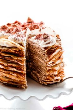 This tiramisu crepe cake features 25 crepes and 24 layers of sweet tiramisu filling made with whipped cream, mascarpone, rum, and espresso. This is a totally impressive, yet very simple no-bake cake. Recipe on sallysbakingaddiction.com