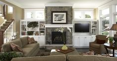 the feel of dark furniture with white cabinetry. TV to the of the fireplace. Bookshelves. Windows above