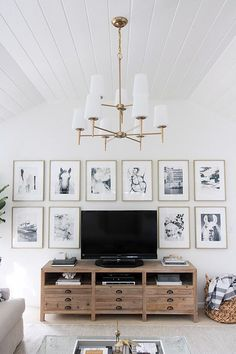 Lots of great before and after pics of a family room makeover - love this art wall surrounding the TV!