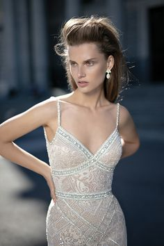 Berta bridal spring / summer 2016 - Love4Wed All beaded wedding dress with silver jewerly-like applique across the waist and bust. This amazing wedding dress from the  Berta spring / summer 2016 collection features a deep open back and triangle shapes at the edge of the train.