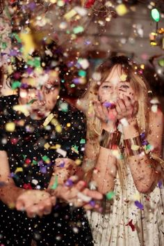 shoot of me blowing confetti wearing @Jody Candrian cuffs