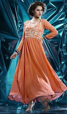 Exhibit the confidence in your looks and style as you don this orange color embroidered georgette Anarkali style tunic. The lace and resham work appears to be chic and ideal for any occasion. #orangetunic #onlinetunic #tunic