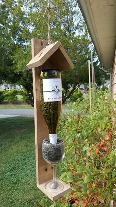This is a great little bird feeder that allows you to display your favorite bottle of wine. The adjustable wire allows you to fit any size bottle. Comes with a wine glass. You add your favorite wine bottle. The base has a 3 inch circular slot cut c