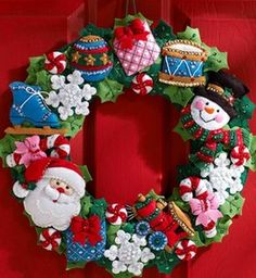 "FELT STITCHERY KIT - CHRISTMAS TOYS WREATH  A beautiful wreath of Christmas toys for you to make as a wall hanging or door decoration 15"" x 15"".  Festive designs, quality materials and generous embellishments from Bucilla ® Felt Home Décor accents are a pleasure to stitch and to display."
