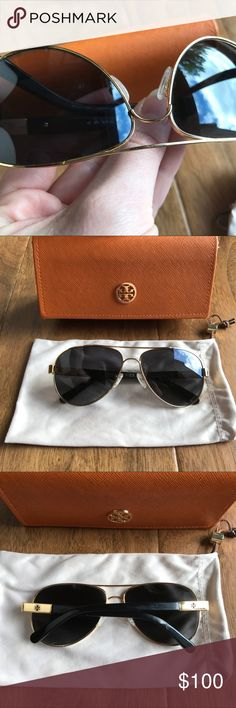 Tory Burch Polarized Aviator Sunglasses TY6010 Classic Black & Gold Aviator. These were my go to glasses so there is slight wear on the frame, arms, and lenses - lense wear is not noticeable when wearing. One of the arm screws fell out awhile ago and when I went to SunglassHut to have them replace it, they only had a silver screw - see photo. These were fit to my face so you may need to bend an arm to fit yours as well (that is why one arm falls lower when folded). Comes with protective bag…