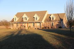 This Executive Custom built home is for sale in Howell County Missouri and is located in a private setting on 20 acres in the Heart of the Ozarks. This home's exterior is brick and stone with a beautifully landscaped walkway to a covered entrance that stretches the length of the house. This home boasts hardwood and tile floors,vaulted ceilings,a stamped tin and tile ceiling in the custom built kitchen and formal dining area,a large kitchen island and an abundance of countertops in West…