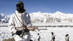 Indian soldiers patrolling the Siachen Glacier; an area that borders India and Pakistan. Note the INSAS rifle.