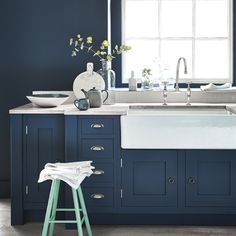 This hits many notes of my dream kitchen, including in-frame cabinets painted in beautiful shade of what looks to be Farrow & Ball Stiffkey blue.