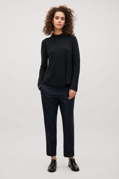 COS Ripple stitch A-line jumper in Indigo and straight navy pants.  Stylish casual minimalist outfit   Minimalist casual wear   Capsule wardrobe   Slow fashion   Simple style   Minimalist style   Stylish business casual   Scandinavian casual wear   Stylish work outfit by COS