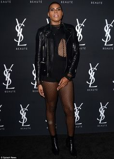 Bold: EJ Johnson kept it edgy in an outfit which strongly featured fishnet fabric worn over a black bodysuit