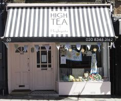 Perfect little shop front with black and white striped awning.  #commercialconstruction #shop #awning