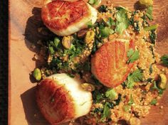 Seared scallops top spicy quinoa that's mixed with ribbons of kale and crunchy pistachios for a quick and easy weeknight meal.\n