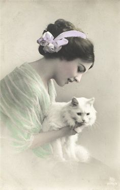 A gorgeous hand tinted Edwardian image of a young lady and a white cat
