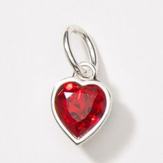 <3 Charms?  One of many... this is the Viva Love Charm - Silver-plated charm features brilliant SWAROVSKI ELEMENTS in Light Siam Crystal. $16  Touchstone Crystal - A Swarovski Company