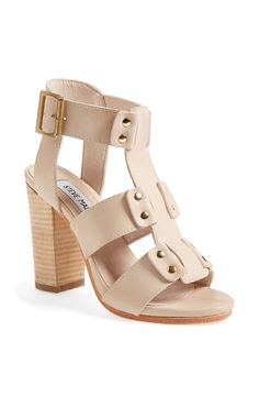 A bright pedi would go great with these fun nude sandals