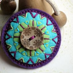 Valinčina Brooch by Crochetka featuring felt, embroidery and beautiful button.