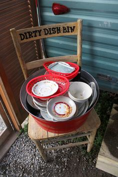 Set out a cute and clearly marked dirty dish bin for guests. | 27 Best Summer Party Hacks