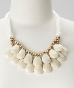 Take a look at this White Teardrop Bib Necklace by Baubles  $14