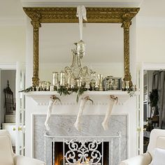 Recreate the over mantel using a repurposed bathroom mirror and adding stair balusters to side and shelf or crown molding at top