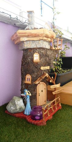 Fairy house made from a cherry trunk.