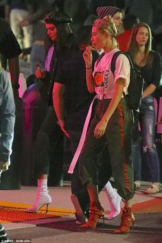 Precious cargo:Hailey opted for green cargo pants with a burnt orange stripes down the sides and matching burnt orange booties