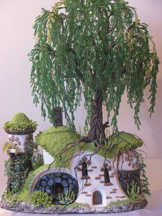 A truly amazing tutorial to create this Hobbit style house, tree and plants made from beads - in Russian but lots of really good pictures.