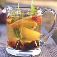 Sun-ripened fruit and lively fresh herbs characterize this refreshing punch, which originated in Spain and Portugal. Serve this sangria with a spoon so that guests may enjoy any flavor-infused fruit that falls to the bottom of the glass.