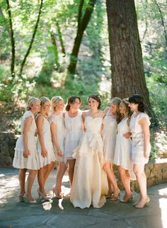 Mix and Match Short Bridesmaid Dresses - I don't know if I would have all my bridesmaids wear white, but I definitely like having them all choose their own dress, in one matching color -  RED.