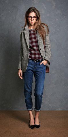 grey blazer, blue jeans, plait shirt.