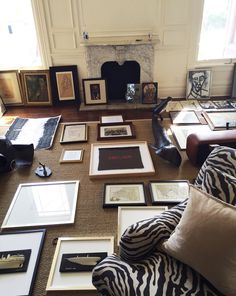 A mix of art from Pottery Barn, Ken Fulk and select vintage shops gets prepped to become a gorgeous gallery wall. (Side note: We can't get enough of our Carlisle Chair upholstered in this new zebra print! Urban Cottage, Cottage Farmhouse, Ken Fulk, California Style, Humble Abode, Upholstered Chairs, Zebra Print, Pottery Barn, Vintage Shops