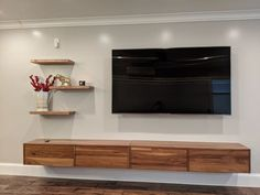 With its sleek floating design, our Hover wall-mounted cabinet is a modern minimalist storage solution for an entryway or living room. Living Room Tv, Living Room Furniture, Kitchen Furniture, Dining Room, Armoires Murales Tv, Floating Cabinets, Floating Media Cabinet, Built In Tv Cabinet, Floating Tv Shelf