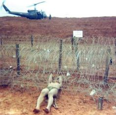 """""""A VC guerrilla showing the Army brass how they get through the wire."""" ~ Vietnam War"""