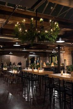 At Morgan Manufacturing's party in Chicago in December 2014, Event Creative designer Leslie Zaksas used fresh greens to decorate the venue's chandeliers for a festive feel and smell.  Photo: Eric Rademacher
