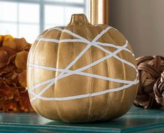 Gold Geometric pumpkin featuring FolkArt paint #plaidcrafts #diy