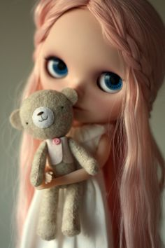 so cute - I am a sucker for dolls with their own dolls or toys