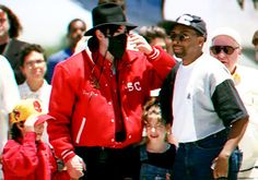 """Michael Jackson and filmmaker Spike Lee, right, arrive at the airport in the northeastern Brazilian city of Salvador on Friday, Feb. 9, 1996 to shoot scenes for Jackson's video for """"They Don't Care About Us."""""""