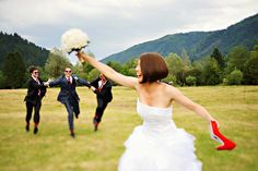 Groom running to the wedding bouquet, bride holding her red wedding shoes www.samorovan.com