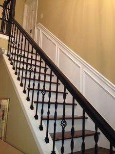 Iron balusters and wainscoting
