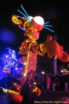 Tigger, from Winnie the Pooh, in the Disney Paint the Night Parade at Disneyland in California.  This parade will be a highlight of any trip to Disneyland.  For more great Disneyland gems and secrets, see: http://www.buildabettermousetrip.com/disneyland-gems/