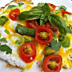 """Spring Omelet   """"Yum! This was very tasty! I added cherry tomatoes cut into 4ths and some mixed cheddar/mozzarella cheese. I also added some basil and black pepper."""""""