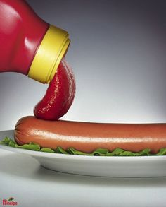 The ketchup appears to be a tongue licking a hot dog (penis). The advertisers have designed this to be food but it is obvious that there is innuendo behind it.