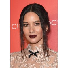 If you're more comfortable pulling your hair back—be it in a bun, or a braid, or just an untidy cluster—considering loosening things up the way hairstylist Keith Carpenter did for Olivia Munn.