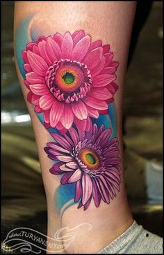 Beautiful Gerber daisies by the Russian tattoo artist Turyanskiy.  I'd have blue and white flowers