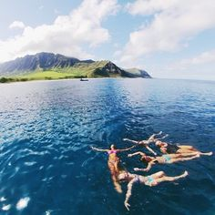 | wading in the ocean sea at the beach in a tropical island paradise like hawaii with friends |