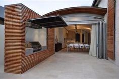 outdoor BBQ area with awning that closes