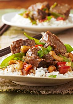 Slow-Cooker Asian-Style Beef -- In this delicious recipe, chunks of beef get meltingly tender in the slow-cooker, simmered in an Asian-inspired blend of toasted sesame dressing, garlic and teriyaki sauce.