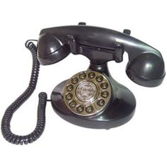Alexis Decorator Phone in Black Paramount Model: 1922 Plastic construction Push button dialing in a rotary fashion plate Last number redial Handset volume control (low/high) Ringer volume control (low/high) Gender: unisex.