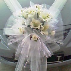 http://divineweddingplus.com/wp-content/uploads/2011/11/Wedding-Car-Flowers-decoration-03.jpg