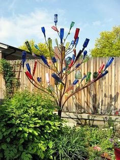 Intelligent Ways to Use Your Old Wine Bottles can find Bottle trees and more on our website.Intelligent Ways to Use Your Old Wine Bottles Wine Tree, Wine Bottle Trees, Old Wine Bottles, Wine Bottle Art, Wine Bottle Crafts, Glass Bottles, Wine Bottle Garden, Bottle Wall, Lighted Wine Bottles