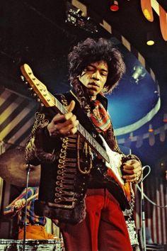 A Jimmy Hendrix le gusta tocar la guitarra.